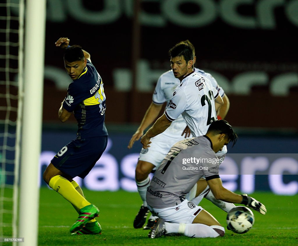 Walter Bou of Boca Juniors and Fernando Monetti of Lanus fight for the ball during a match between Lanus and Boca Juniors as part of first round of...