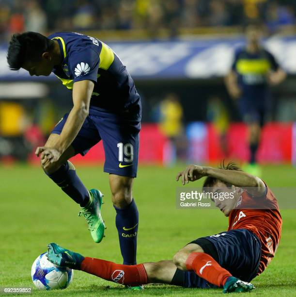 Walter Bou of Boca Juniors fights for the ball with Nicolas Tagliafico of Independiente during a match between Boca Juniors and Independiente as part...