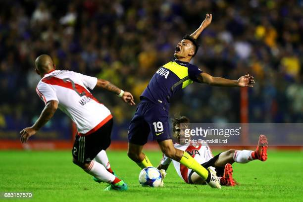 Walter Bou of Boca Juniors is fouled by Leonardo Ponzio of River Plate during the Torneo Primera Division match between Boca Juniors and River Plate...