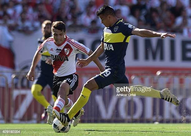 Walter Bou of Boca Juniors kicks the ball to score the first goal of his team during a match between River Plate and Boca Juniors as part of Torneo...