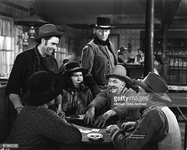 Walter Brennan John Wayne and Chief Yowlachie on the set of the movie 'Red River' in 1948 in the Whetstone Mountains Arizona