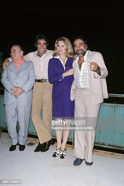 Walter Chiari Italian actor comician and TV host posing with the Italian actors Carlo Campanini Sylva Koscina and Alberto Lupo at the end of their...