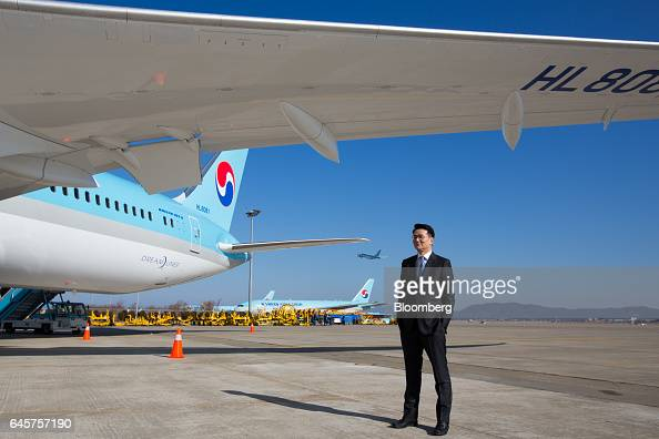Walter Cho president of Korean Air Lines Co poses for a photograph in front of the company's Boeing Co 7879 Dreamliner passenger aircraft at Incheon...