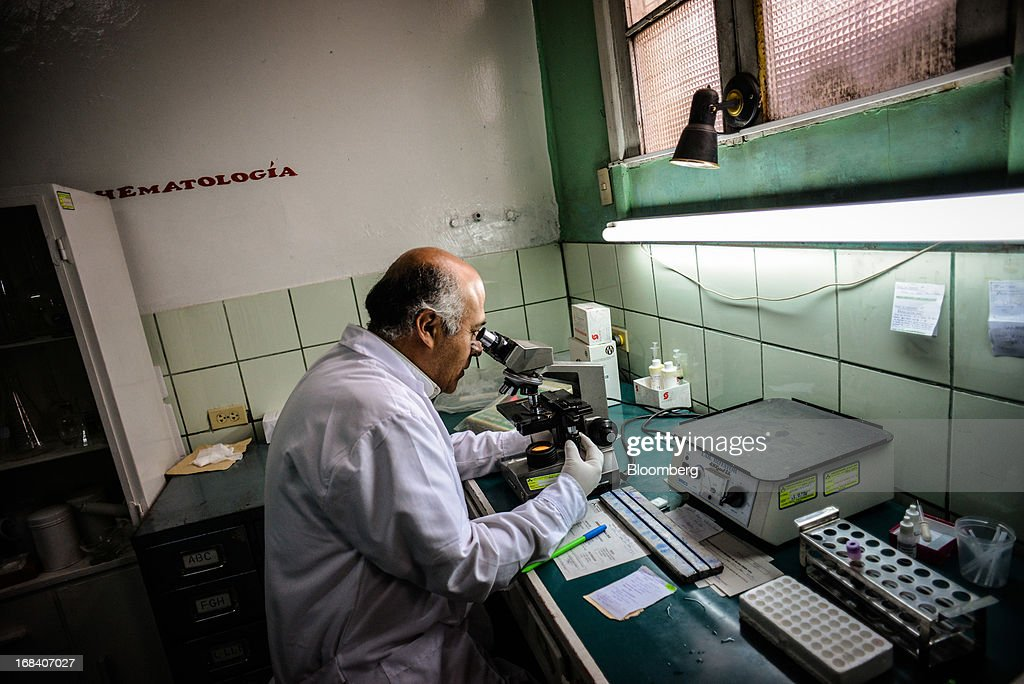 Walter Condor, medical technologist and expert in heavy metals, works in a laboratory in the La Oroya health center in the town of La Oroya, Peru, on Thursday, March 21, 2013. Most of La Oroyaís children suffer elevated lead levels, according to the Peruvian government. The question of responsibility for lead pollution in La Oroya is at the center of high-stakes clash between Peru and U.S. billionaire Ira Rennert, who owned Doe Run Peru for more than a decade through Renco Group Inc., a metals, mining and industrial conglomerate based in New York that has said it is not responsible for the childrenís ills. Photographer: Meridith Kohut/Bloomberg via Getty Images