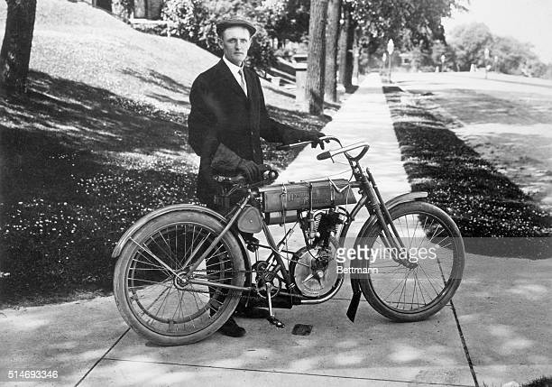 Walter Davidson the first president of the Harley Davidson Motor Company poses with his bike after winning the 1908 Federation of American...