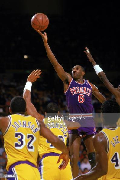 Walter Davis of the Phoenix Suns shoots against the Los Angeles Lakers during the game at the Great Western Forum in Inglewood California