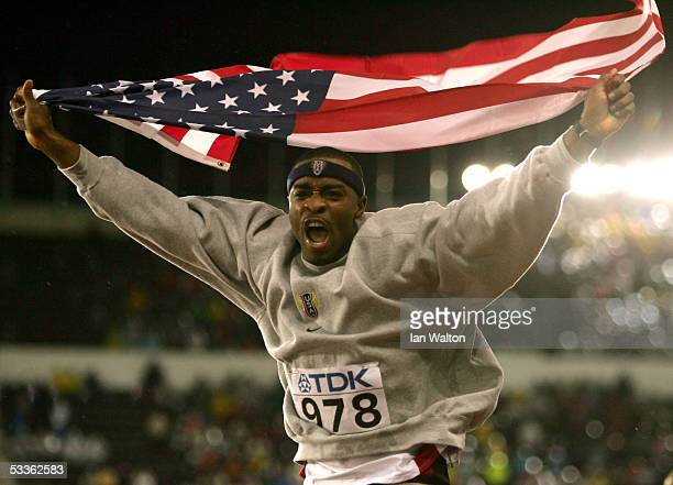 Walter Davis of USA celebrates after he won gold in the men's Triple Jump final at the 10th IAAF World Athletics Championships on August 11 2005 in...