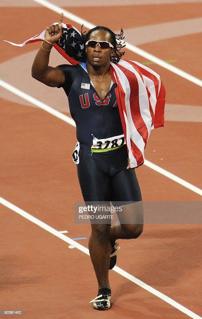 Walter Dix of the US celebrates after finishing third in the men's 100m final at the 'Bird's Nest' National Stadium during the 2008 Beijing Olympic Games on August 16, 2008. Jamaica's Usain Bolt won the Olympic Games men's 100m gold medal in a new world record time of 9.69sec. Trinidad and Tobago's Richard Thompson (9.89sec) and Walter Dix of the US (9.91) took silver and bronze respectively.