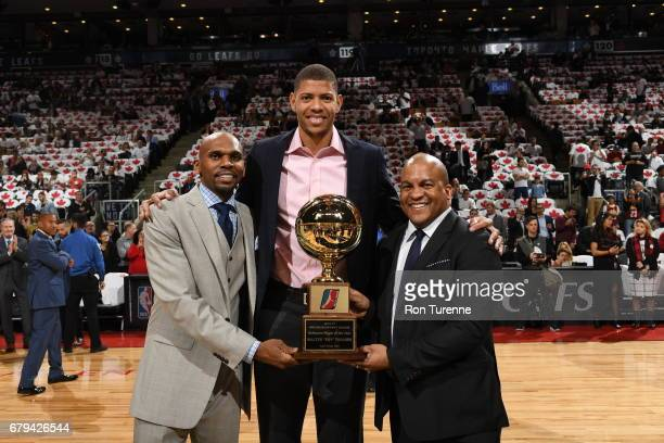 Walter 'Edy' Tavares of the Raptors 905 receives the DLeague defensive player of the Year award before the game between the Toronto Raptors and the...