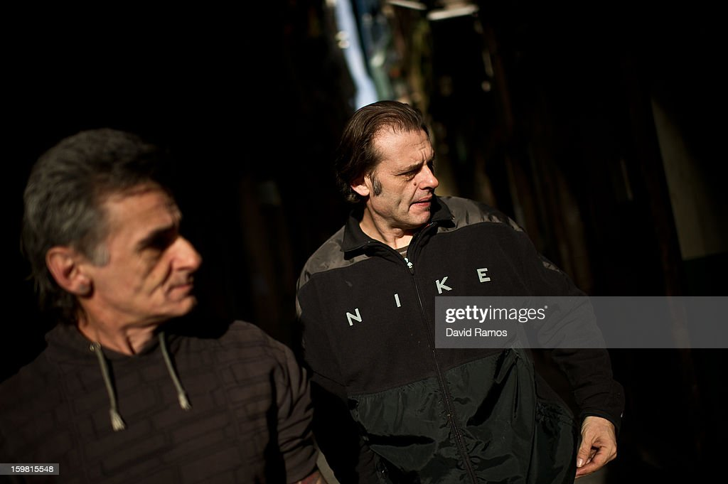 Walter from France, 55, and Juan from Spain, 50 walk in the downtown of Barcelona after delivering pastries in a Supervised Injection Site (SIS) on January 4, 2013 in Barcelona, Spain. The German pastor Wolfgang Striebinger has lived in Barcelona since 1991, originally employed to minister to youths during the Barcelona Olympic Games, he decided to stay and since 2000 has run 'El Chinguito de Dios' (The Stall of God). In his mission to support the homeless, Wolfgang and his volunteers offer a place for up to 200 people to come and have some food daily and also offering them assistance with grooming and clothes. Many of the volunteers are homeless and help out in return for meals and a bed. Wolfgang's ethos is to provide peace, calm and dignity to all those that need it amongst Barcelona's burgeoning homeless population. Due to the economic situation his doors are now also open to the long term unemployed and families with little or no income. According to the latest figures 21.8% of the Spanish populations are living below the poverty line.