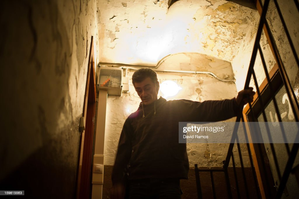 Walter from France, 55, walks down the stairwell in the 'El Chiringuito de Dios' ('The Stall of God') on January 4, 2013 in Barcelona, Spain. Walter served the French Foreign Legion for 17 years and he is a sheet-metal worker specialized in Harley-Davidson bikes. After that, he was working in the building industry until 2006. He was 4 years seeking for job and he arrived to Barcelona from Marseille in 2010 where he has been living on the streets . Wolfgang Striebinger offered him 2 years ago a bed and meals in return for helping him serving the meals in the 'El Chiringuito de Dios' ('The Stall of God'). The German pastor Wolfgang Striebinger has lived in Barcelona since 1991, originally employed to minister to youths during the Barcelona Olympic Games, he decided to stay and since 2000 has run 'El Chinguito de Dios' (The Stall of God). In his mission to support the homeless, Wolfgang and his volunteers offer a place for up to 200 people to come and have some food daily and also offering them assistance with grooming and clothes. Many of the volunteers are homeless and help out in return for meals and a bed. Wolfgang's ethos is to provide peace, calm and dignity to all those that need it amongst Barcelona's burgeoning homeless population. Due to the economic situation his doors are now also open to the long term unemployed and families with little or no income. According to the latest figures 21.8% of the Spanish populations are living below the poverty line.