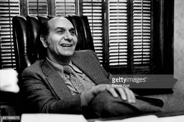 Walter Gerash in a Lighthearted Moment at His Desk If there is a madness to him it is also his method and it works Credit Denver Post