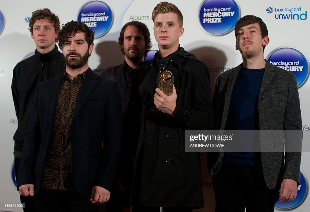 Walter Gerver, Yannis Philippakis, Jimmy Smith, Jack Bevan and Edwin Congreave of British indie rock band, Foals, pose with their Albums of the Year trophy at the 2013 Mercury Prize awards ceremony in central London on October 30, 2011. The Mercury Prize seeks to promote the best of UK and Irish music and the artists that produce it. This is done primarily through the celebration of the 12 Albums of the Year. The12 shortlisted artists receive a specially commissioned bronze Albums of the Year trophy.