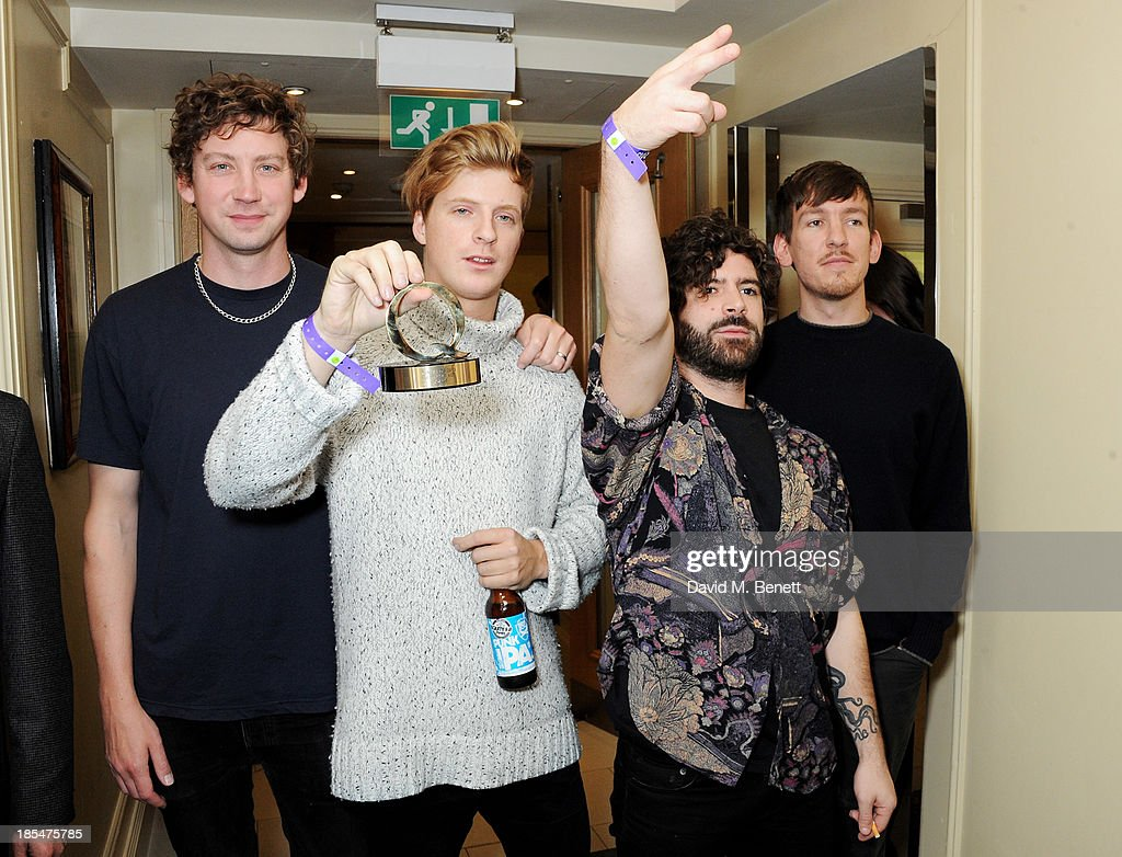 Walter Gervers, Jack Bevan, <a gi-track='captionPersonalityLinkClicked' href=/galleries/search?phrase=Yannis+Philippakis&family=editorial&specificpeople=4453909 ng-click='$event.stopPropagation()'>Yannis Philippakis</a> and Edwin Congreave of Foals, winners of the Best Live Act, pose in the press room at The Q Awards at The Grosvenor House Hotel on October 21, 2013 in London, England.