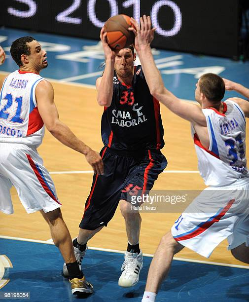 Walter Herrmann of Caja Laboral competes with Trajan Langdon and Viktor Khryapa of CSKA Moscow during the Euroleague Basketball 20092010 Play Off...