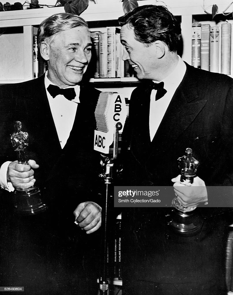 Walter Huston and his son John Huston exchange congratulations after they won academy awards for their work in 'Treasure of the Sierra Madre' Walter...