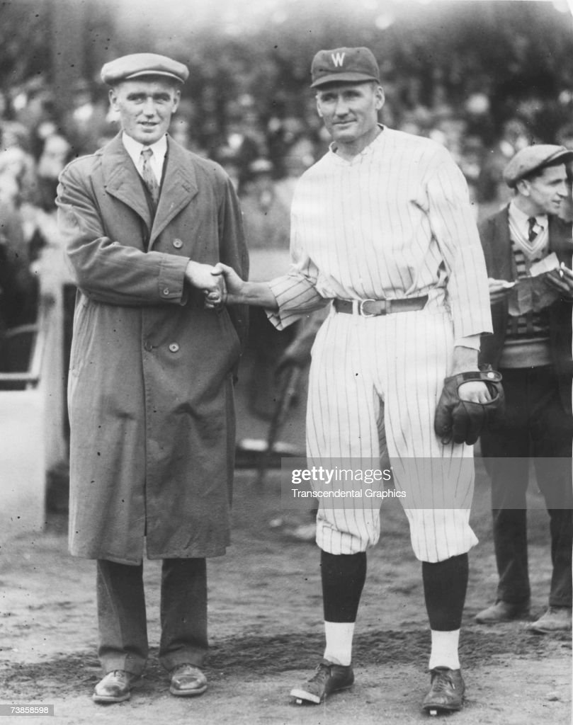 WASHINGTON OCTOBER 11 1925 Walter Johnson has just shut out the Pittsburgh Pirates in game four of the 1925 World Series and is congratulated by his...