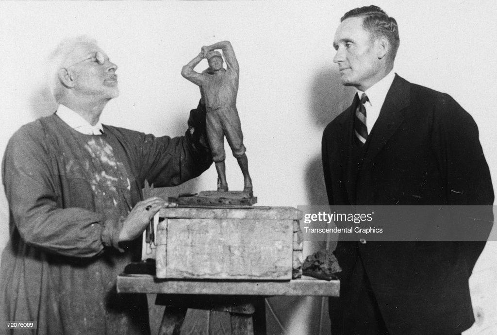 Walter Johnson Senators pitcher poses with sculptor USJ Dunbar who is constructing a likeness of Johnson in Washington DC