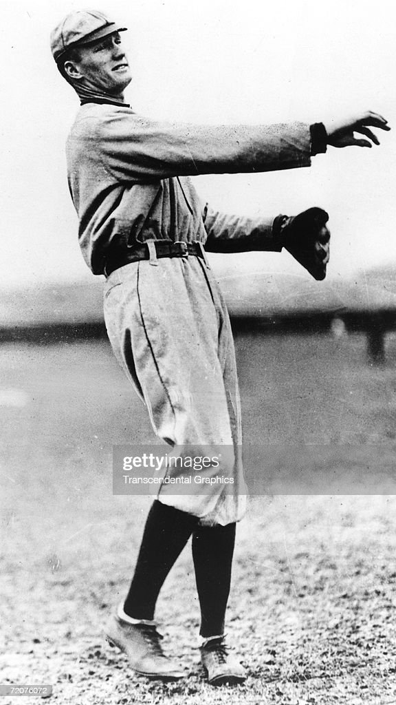 Walter Johnson Senators rookie pitcher in 1907 stretches out his long right arm before a game in National Park in Washington DC