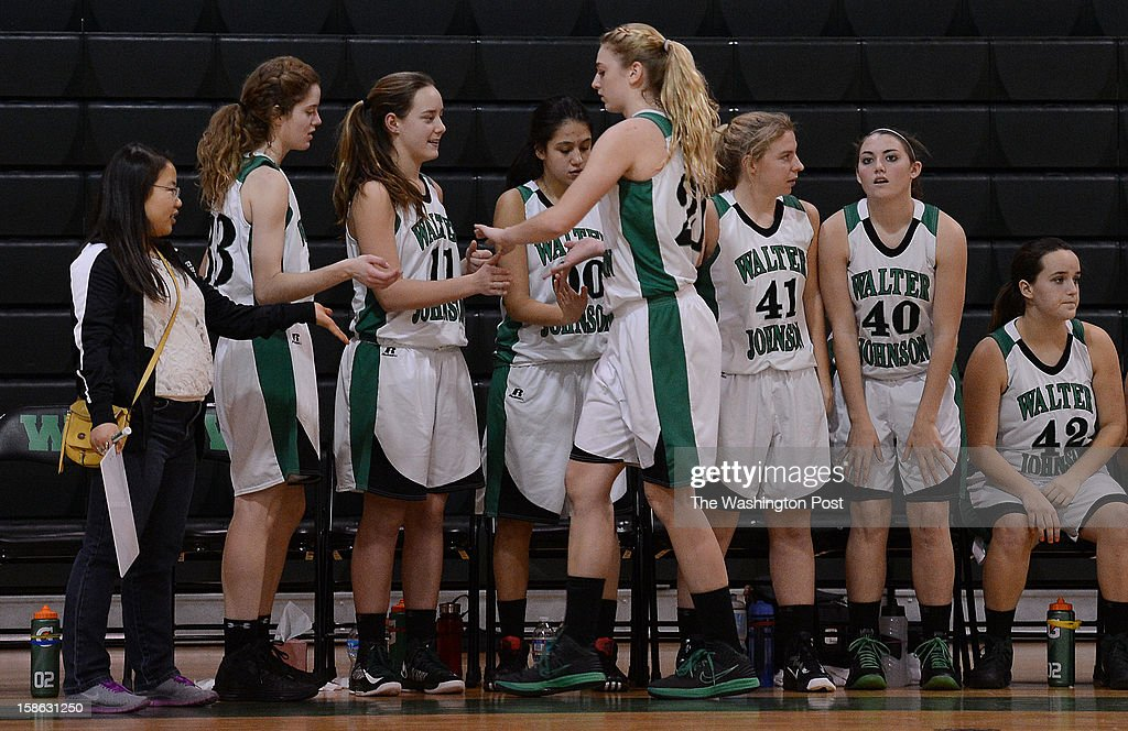 Walter Johnson's Kristen Larrick high fives the bench after coming out of the game for a break during the game at Walter Johnson High School on Friday, December 21, 2012. Whitman defeated Walter Johnson 44-42.