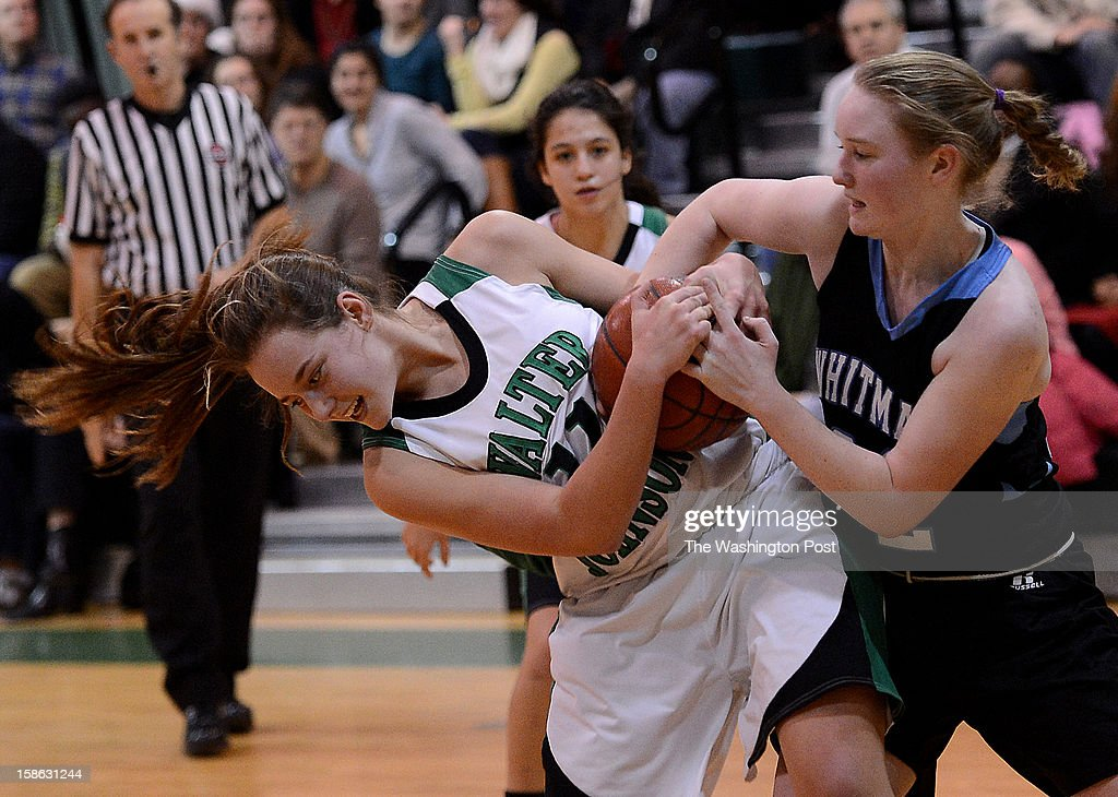 Walter Johnson's, left, and Whitman's Marie Hatch, right, battle for the ball during the game at Walter Johnson High School on Friday, December 21, 2012. Whitman defeated Walter Johnson 44-42.
