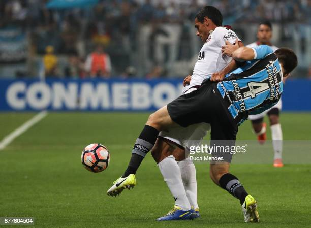 Walter Kannemann of Gremio struggles for the ball with Jose Sand of Lanus during a first leg match between Gremio and Lanus as part of Copa...
