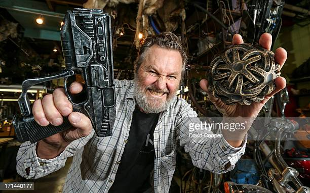 Walter Klassen holds a fantasy gun that actually fires blanks that was created on his 3D printer and a fantasy alien throwing star also 3D printed...