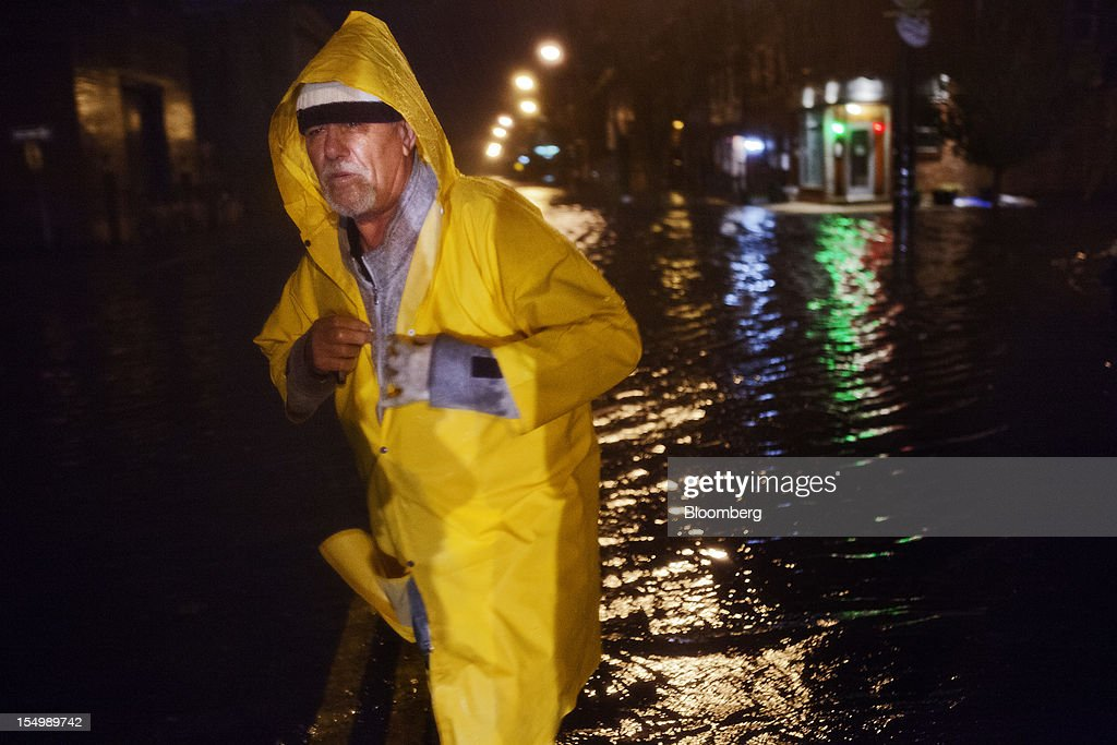 Walter Martiniano wades through a flooded street in the Red Hook neighborhood of Brooklyn in New York, U.S., on Monday, Oct. 29, 2012. Hurricane Sandy, the Atlantic's Ocean's biggest-ever tropical storm, barreled toward southern New Jersey after bringing a region with 60 million residents to a virtual standstill and upending the U.S. presidential race eight days before Election Day. Photograph: Victor J. Blue/Bloomberg via Getty Images