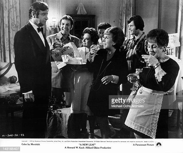 Walter Matthau standing in front of festive crowd of which is Doris Roberts in a scene from the film 'A New Leaf' 1970