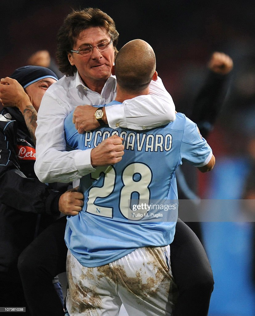 Walter Mazzarri coach of Napoli celebrates with Paolo Cannavaro the Christian Maggio's opening goal during the Serie A match between Napoli and Palermo at Stadio San Paolo on December 6, 2010 in Naples, Italy.
