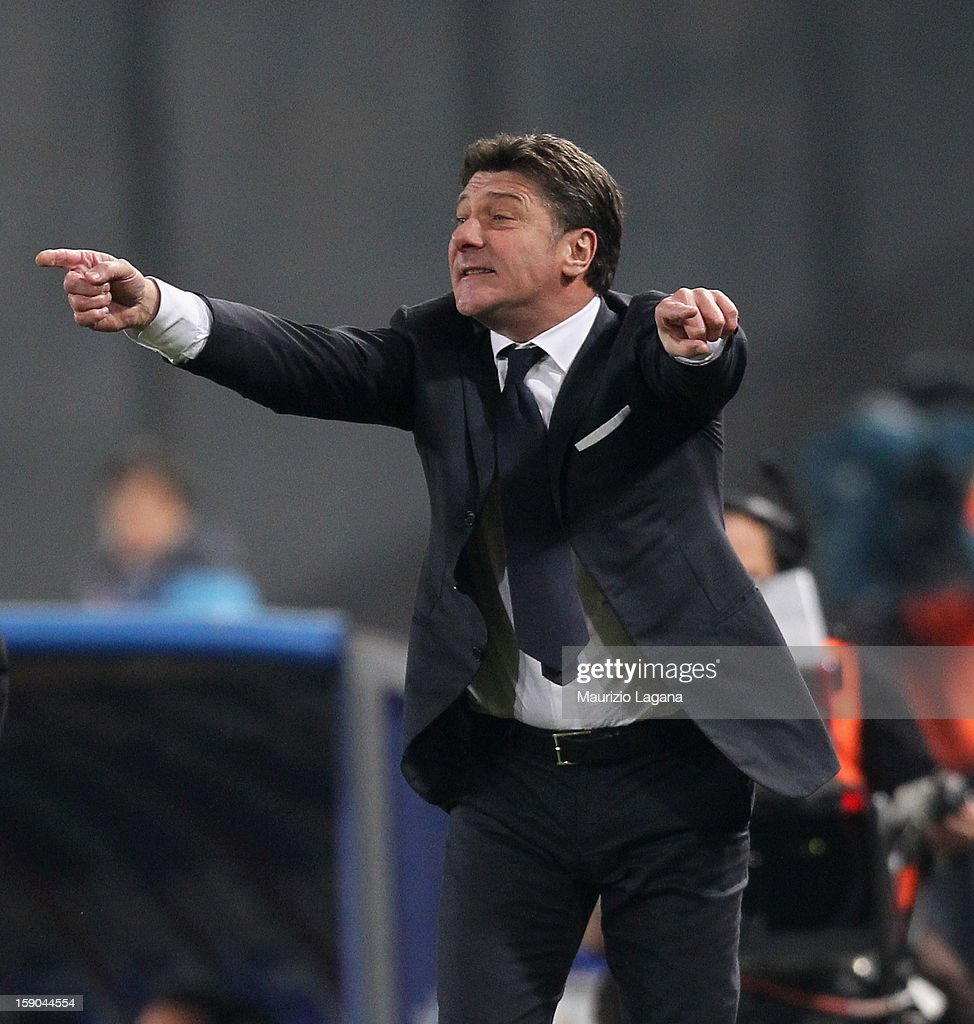 <a gi-track='captionPersonalityLinkClicked' href=/galleries/search?phrase=Walter+Mazzarri&family=editorial&specificpeople=5314636 ng-click='$event.stopPropagation()'>Walter Mazzarri</a> head coach of Napoli gestures during the Serie A match between SSC Napoli and AS Roma at Stadio San Paolo on January 6, 2013 in Naples, Italy.