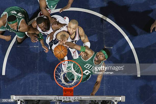Walter McCarty of the Boston Celtics and Kenyon Martin of the New Jersey Nets battles for a rebound in Game two of the Eastern Conference Semifinals...