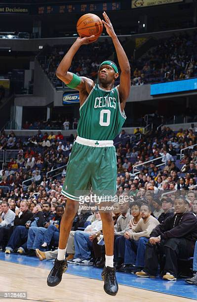 Walter McCarty of the Boston Celtics shoots against the Washington Wizards during the game at MCI Center on March 13 2004 in Washington DC The...