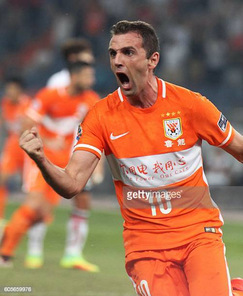 Walter Montillo of Shandong Luneng celebrates a goal against FC Seoul during their AFC Champions League football match in Jinan in China's Shandong...