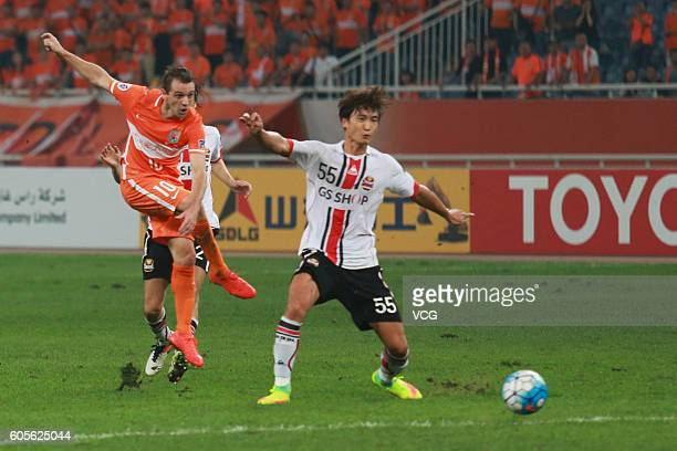 Walter Montillo of Shandong Luneng shoots the ball during the quarter final match of the AFC Champions League between Shandong Luneng and FC Seoul at...