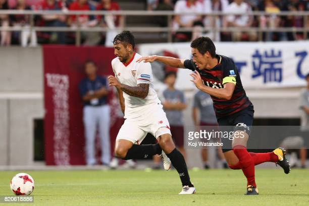 Walter Montoya of Sevilla and Gen Shoji of Kashima Antlers compete for the ball during the preseason friendly match between Kashima Antlers and...