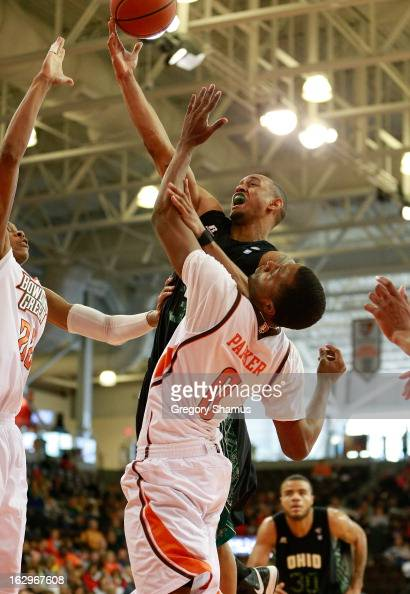 Walter Offutt of the Ohio Bobcats gets to the basket past Spencer Parker of the Bowling Green Falcons during the second half at the Stroh Center on...