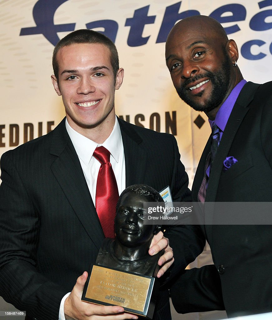 Walter Paton Award winner Taylor Heinicke of Old Dominion University and former NFL player <a gi-track='captionPersonalityLinkClicked' href=/galleries/search?phrase=Jerry+Rice&family=editorial&specificpeople=184559 ng-click='$event.stopPropagation()'>Jerry Rice</a> pose for a photograph during the Sports Network's 26th Annual FCS Awards Presentation at the Sheraton Society Hill on December 17, 2012 in Philadelphia, Pennsylvania.