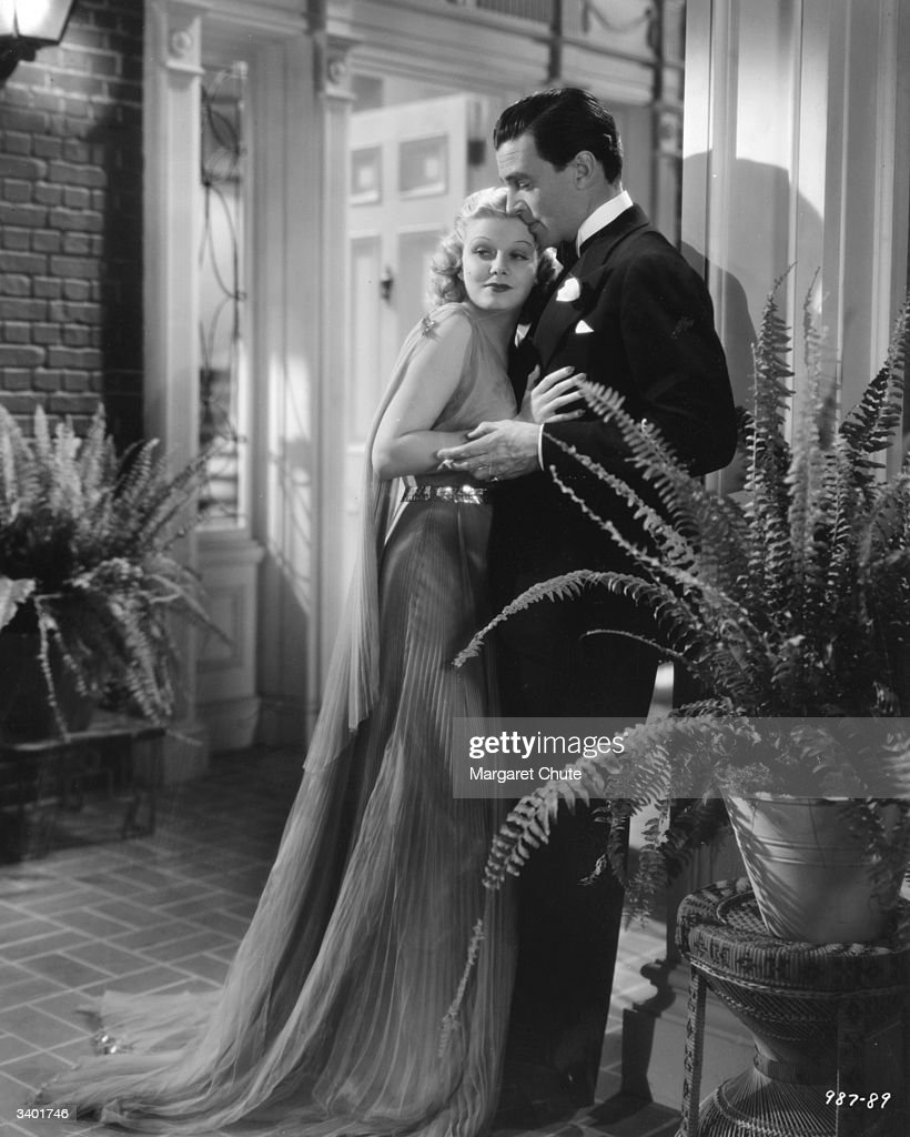 Walter Pidgeon and Jean Harlow (1911 - 1937) star in the film 'Saratoga', with costume designs by Dolly Tree. Harlow died from a cerebal edema during the making of this film and her part was completed by a double.
