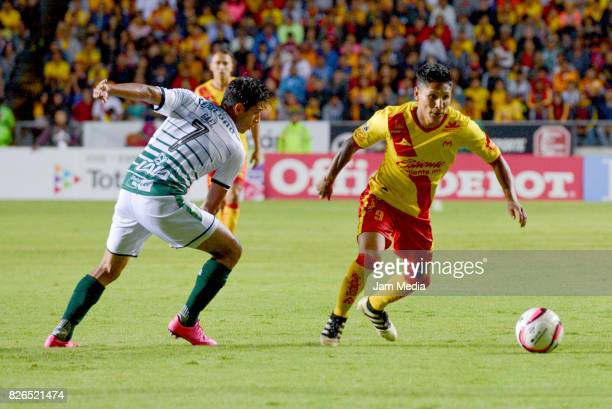 Walter Sandoval of Santos and Raul Ruidiaz of Morelia vie for the ball during the 3rd round match between Morelia and Santos as part of the Torneo...