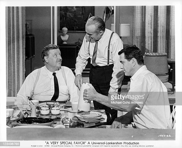 Walter Slezak and Charles Boyer call a conference with Rock Hudson in a scene from the film 'A Very Special Favor' 1965