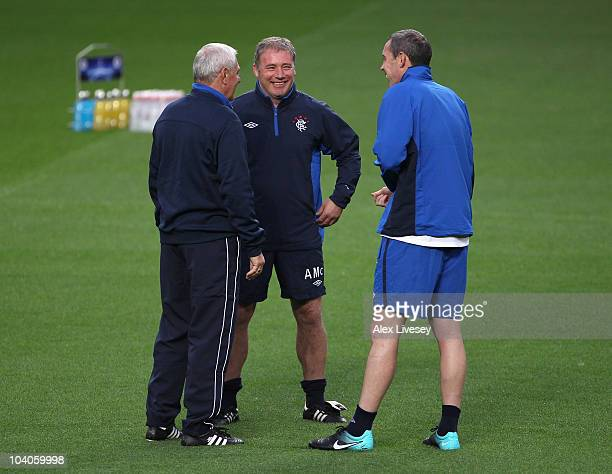 Walter Smith the manager of Rangers talks with Ally McCoist and David Weir during a training session at Old Trafford on September 13 2010 in...