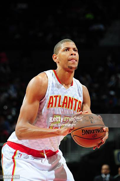 Walter Tavares of the Atlanta Hawks prepares to shoot a free throw against the Miami Heat on October 18 2015 at Philips Arena in Atlanta Georgia NOTE...