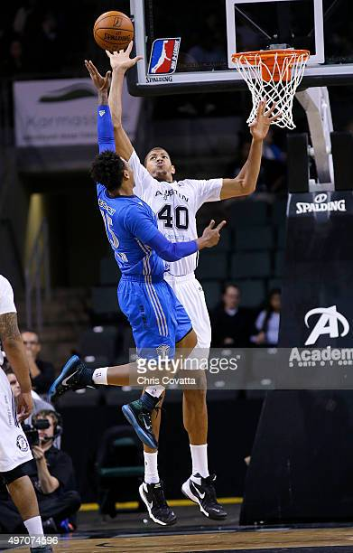 Walter Tavares of the Austin Spurs blocks the shot by Bobby Ray Parks Jr #15 of the Texas Legends at the Cedar Park Center on November 13 2015 in...