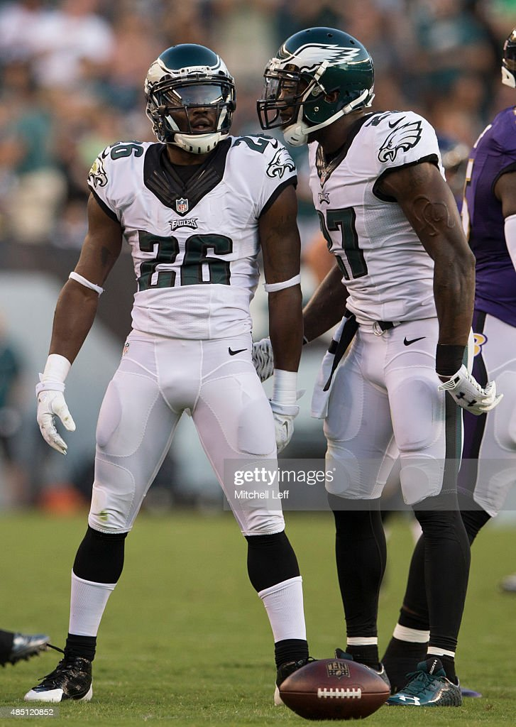 Walter Thurmond and Malcolm Jenkins of the Philadelphia Eagles react after an interception in the game against the Baltimore Ravens on August 22 2015...