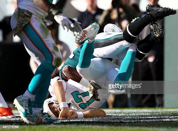 Walter Thurmond of the Philadelphia Eagles sacks quarterback Ryan Tannehill of the Miami Dolphins for a safety in the first quarter at Lincoln...