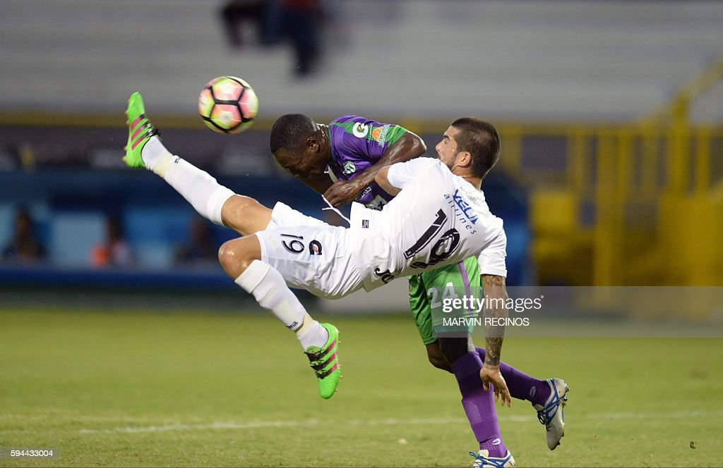 TOPSHOT Walter Vazquez of Salvadorean team Alianza fights for the ball with Roberto Pena of Guatemalan Antigua Guatemala during a CONCACAF Champions...