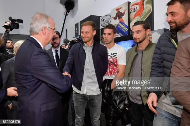 Walter Veltroni and Benedikt Howedes during the Juventus 120 Years Exhibition Opening at Juventus Museum on November 9 2017 in Turin Italy