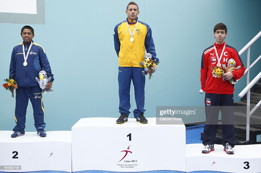 Walter Vera of Ecuator, Alejandro Arias Muñ–oz of Colombia and Vladimir Badilla of Chile pose for a photo after the Men's 3m Springboard Diving Final round as part of the I ODESUR South American Youth Games at Villa Deportiva del Callao on September 26, 2013 in Lima, Peru.