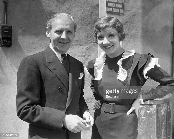 Walter Winchell newspaper columnist visitor at the Paramount studio in Hollywood finds it an easy task to give such a lovely listener as Claudette...